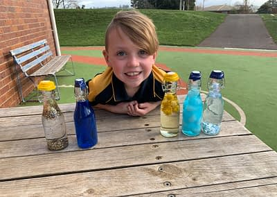 Finn's science models is about weather, each bottle represents a different weather event