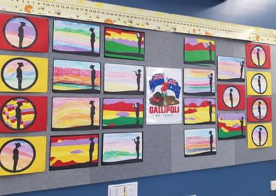 Artwork displayed in classroom with ANZAC themed pictures