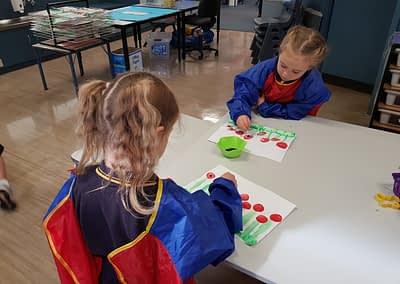 children painting poppies