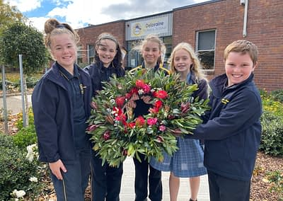 Students holding homemade ANZAC wreath